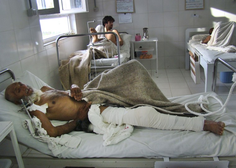 Image: An Afghan man recuperates from his injuries