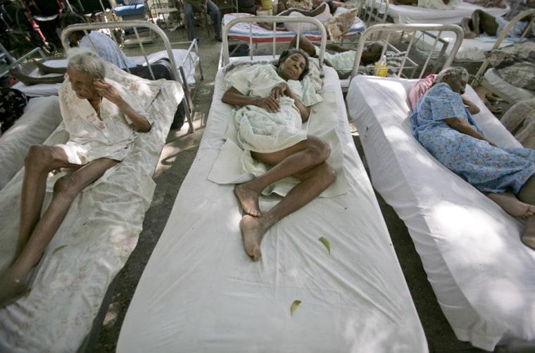 Image: Elderly patients sit outside a nursing home in Port-au-Prince