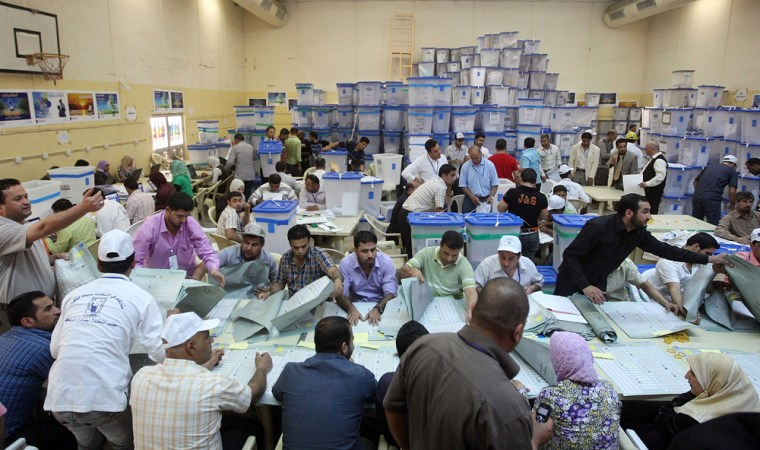 Image: Iraqis count votes at the Independent High Electoral Commission headquarters in Baghdad