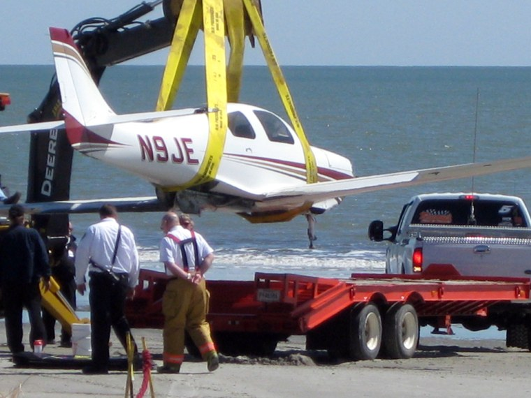 Image: Airplane being loaded onto a truck