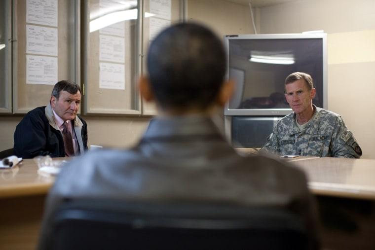 President Barack Obama meets with U.S. Ambassador Karl Eikenberry, left, and Gen. Stanley McChrystal at Bagram Air Field in Afghanistan, Sunday, March 28.