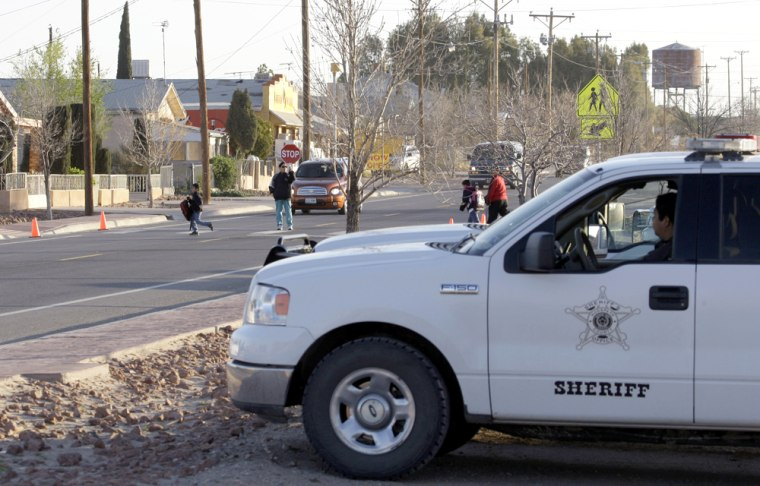 Image: deputy sheriff sits watch as school children cross the street