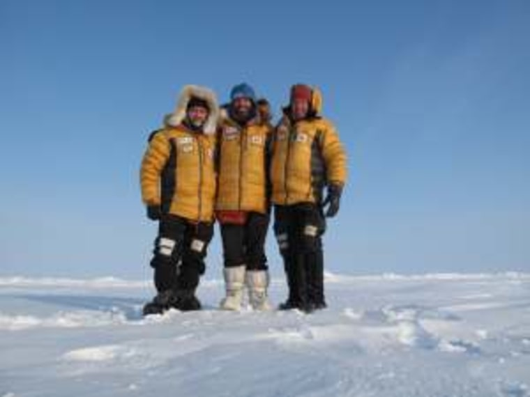 Antony Jinman, Eric Larsen and Darcy St-Laurent standing at the geographic North Pole.
