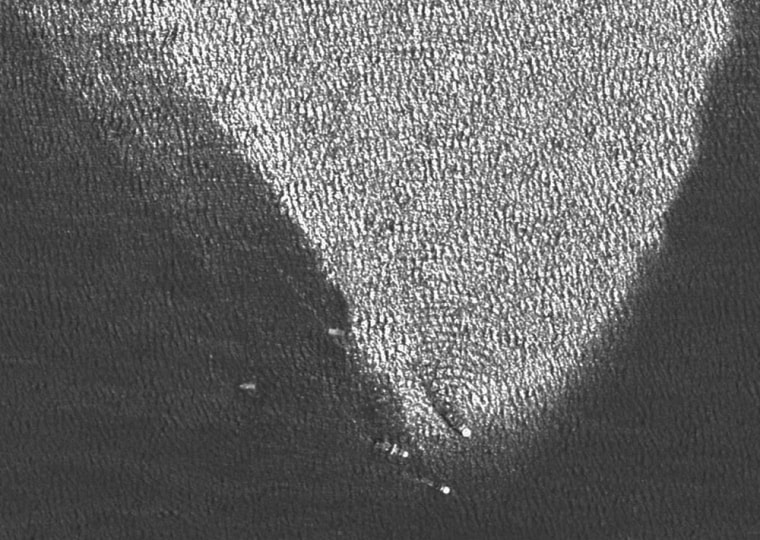 This satellite image shows vessels at the source of the leaking oil, at the same location where just a week before the platform Deepwater Horizon sank after burning for two days.
