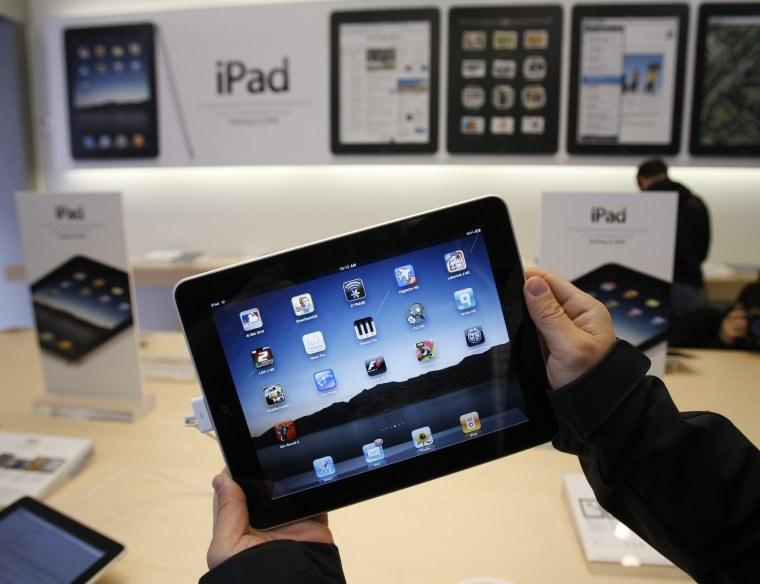 Image: Customer uses an Apple iPad