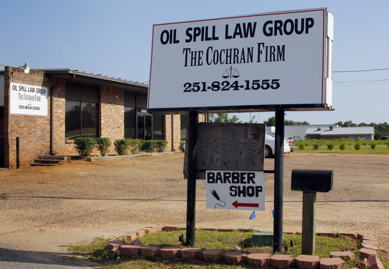 "Image: A new sign advertises the ""Oil Spill Law Group"" in Bayou LaBatre"