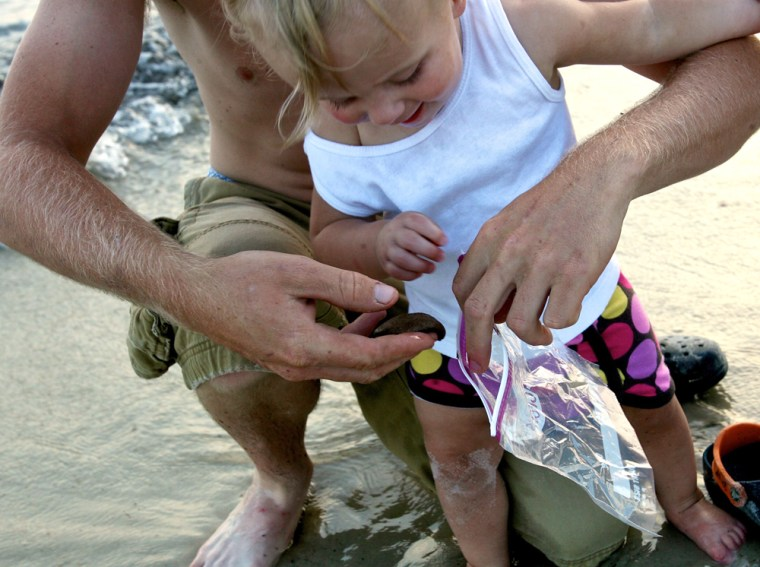 Image: Tar balls wash ashore in Dauphin island, Alabama