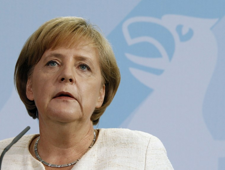 Image: German Chancellor Merkel makes a statement during a news conference at the Chancellery in Berlin