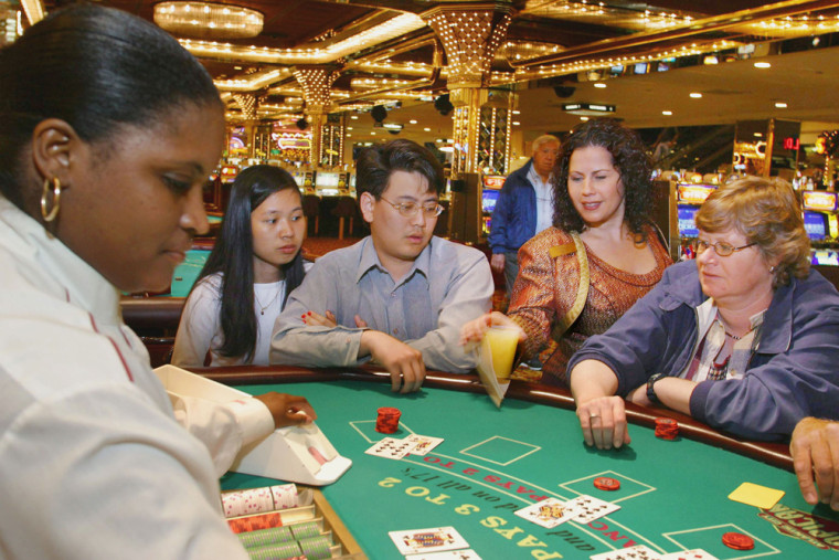 Image: A cocktai server serves a free drink at a casino in Atlantic City,