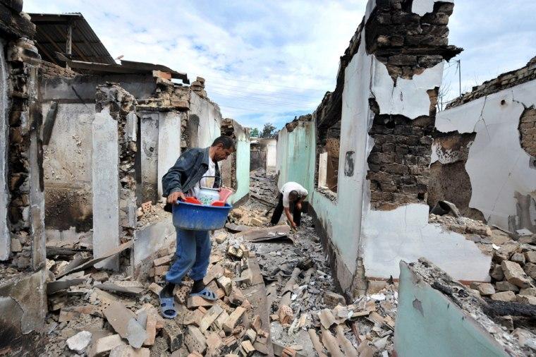 Image: Ethnic uzbek men look for their belongings