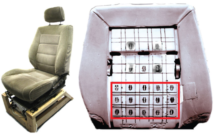 Each black square is a cell phone motor, embedded in the seat, that vibrates to alert the driver of passing cars.