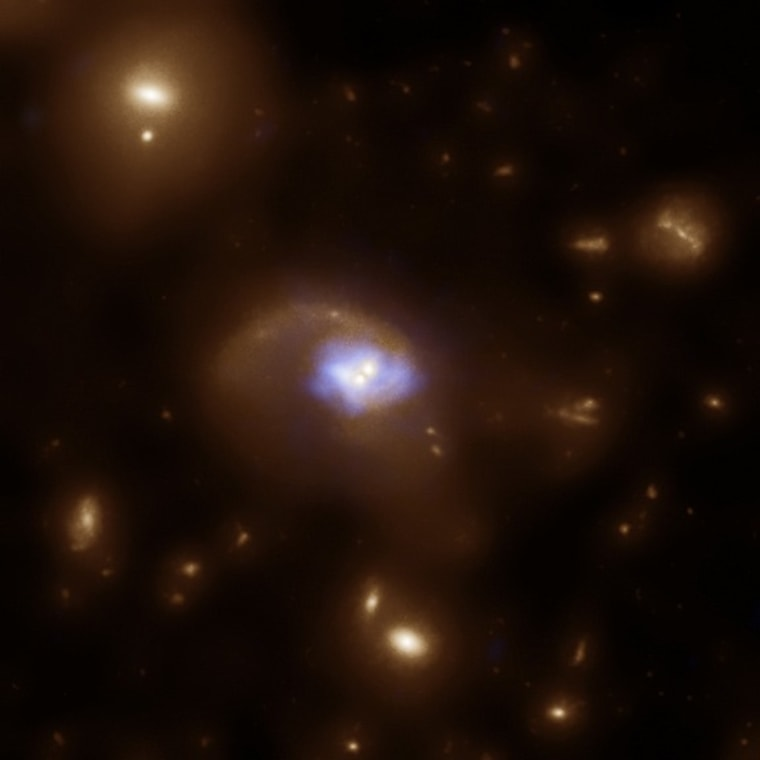 Image: Black holes and stars in space