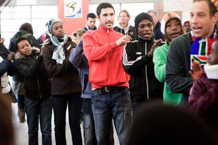 Image: Ethan Zohn in Khayelitsha, South Africa, with aprticipants at the (RED)/Grassroot Soccer camp.