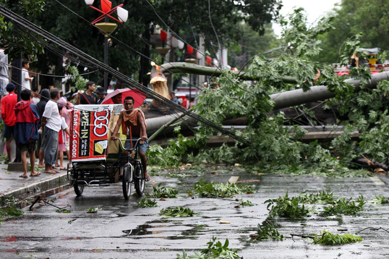 Image: Powerful typhoon batters the northern and eastern Philippines