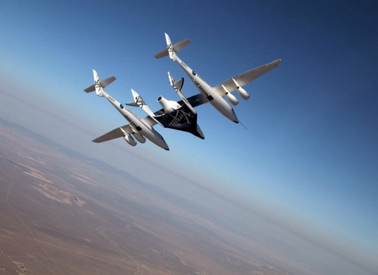 The Virgin Galactic suborbital spaceliner SpaceShipTwo makes its first crewed flight on July 15,2010 over the Mojave Desert in California, one of a series of test flights before the first free flight of the passenger ship for space tourism flights.