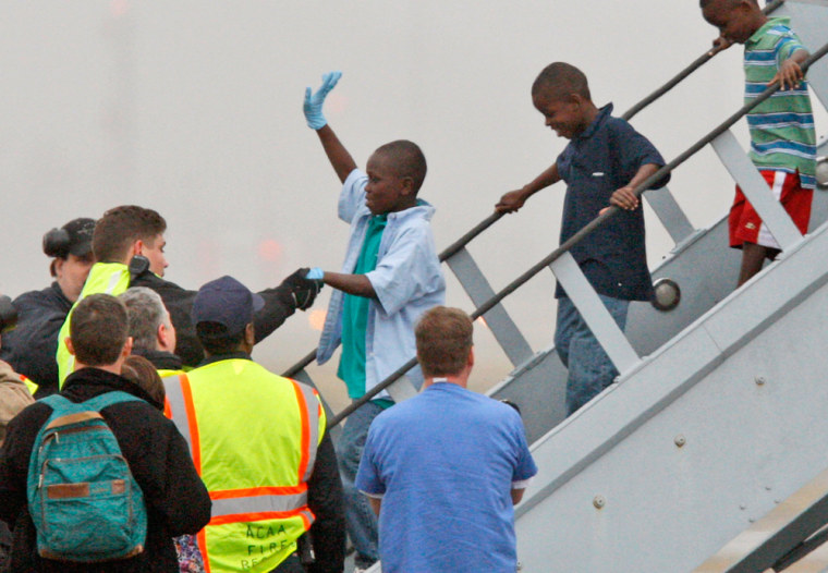 Image: Haitian orphans, whose orphanage was destroyed, arrive at Pittsburgh International Airport on Tuesday, Jan. 19, 2010