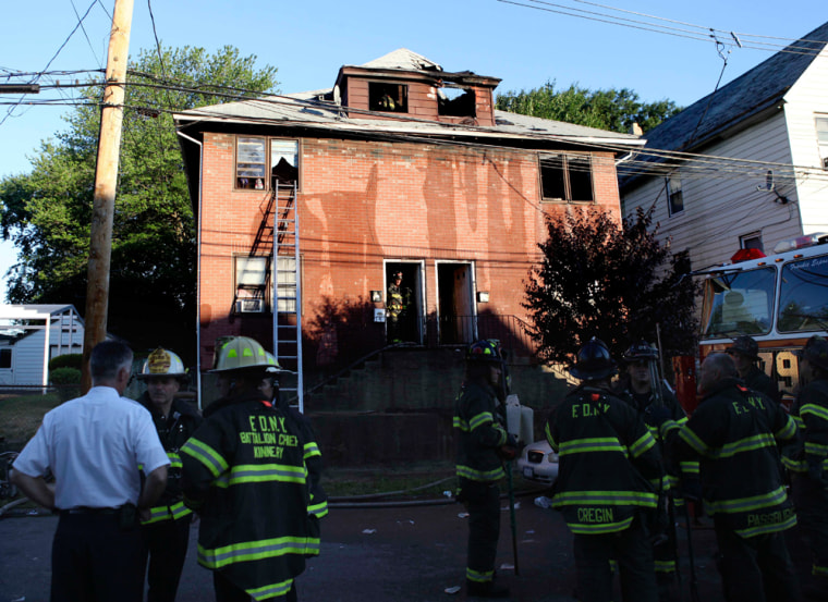 Image: irefighters and other first responders work on the site of a fatal fire