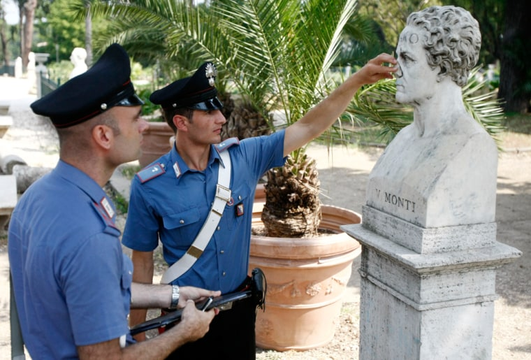 Image:Inspecting damaged bust in Rome
