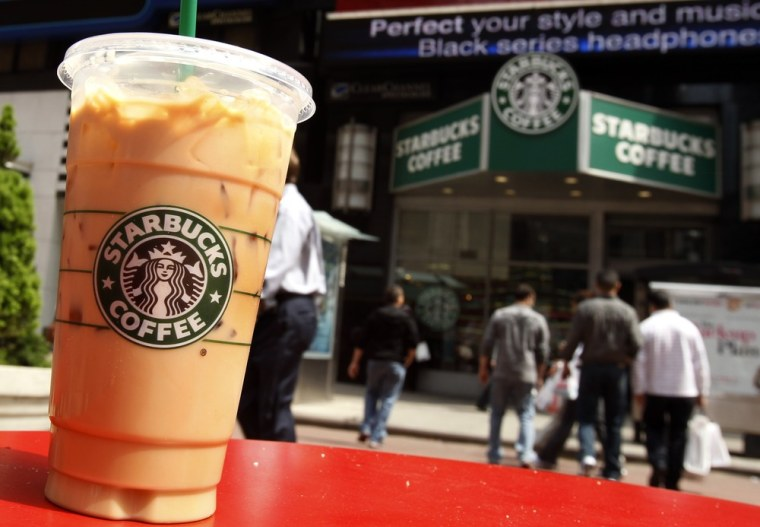 Image: A Starbucks drink is seen on a table in New York's Times Square