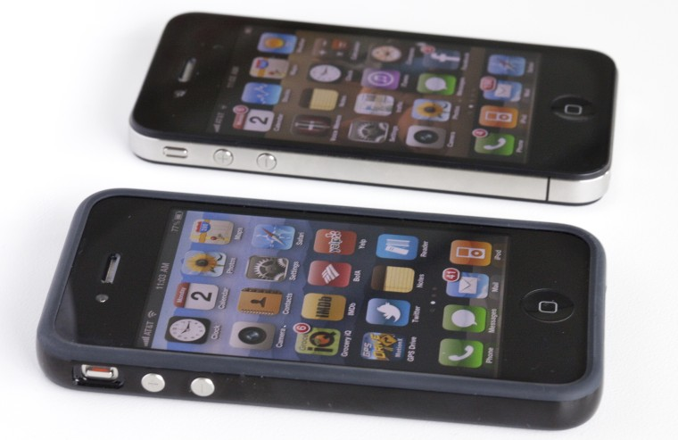 The free bumper for the iPhone 4, shown in the foreground, is easing phone owners' concerns, according a new survey.