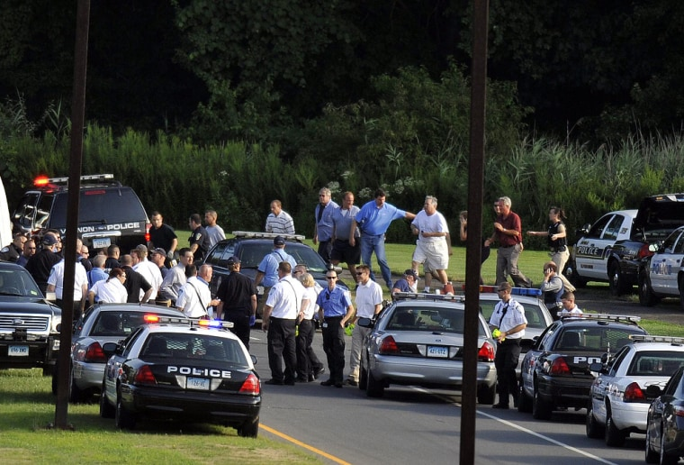 Image: People are seen being evacuated from Hartford Distributors, Inc.