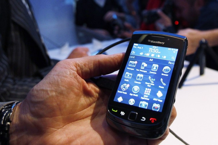 Image: Hand holding the BlackBerry Torch 9800 smart phone