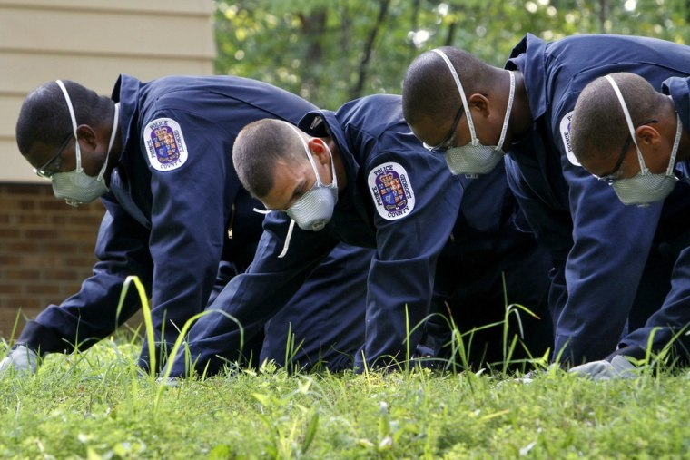 Image: Police recruits search for evidence