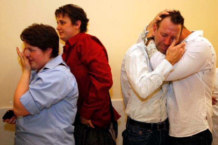 Image: same-sex couples embrace