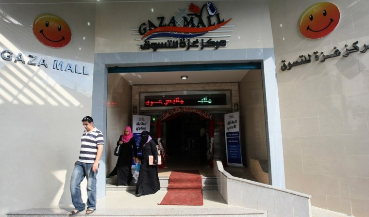 """Image: Palestinians leave the newly opened """"Gaza Mall"""" in Gaza City"""