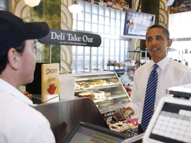 Image: U.S. President Obama orders a corned beef sandwich at a visit to Jerry's Famous Deli in Miami