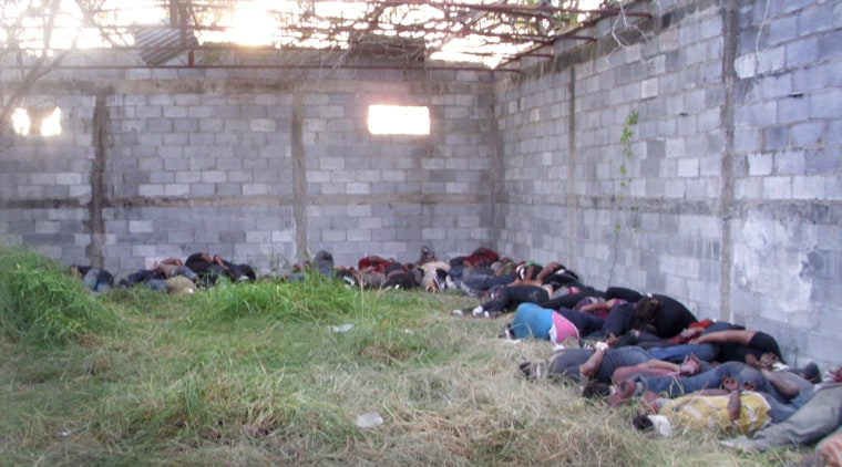 In a photo from Telemundo, the bodies of some of the 72 people killed at a ranch in Mexico are seen shortly after the discovery.