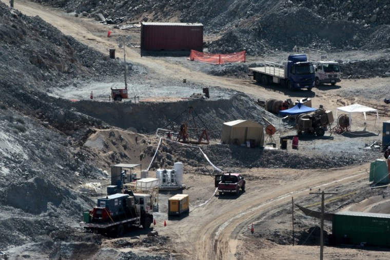 Image: A drill machine, the Xtrata 950, is prepared to start works on the top of a hill where 33 miners are trapped underground in a copper and gold mine at Copiapo