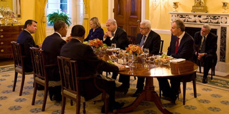 President Barack Obama holds a working dinner with, clockwise from left, King Abdullah II of Jordan, Secretary of State Hillary Clinton, special envoy George Mitchell,Prime Minister Benjamin Netanyahu of Israel, President Mahmoud Abbas of the Palestinian Authority, international envoyTony Blair and President Hosni Mubarak of Egypt, in the Old Family Dining Room of the White House on Wednesday.