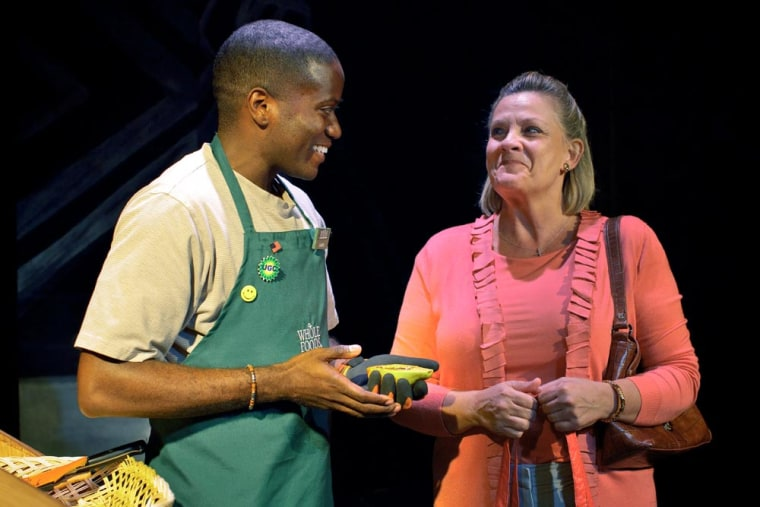 """Warner Miller as Gabriel and Kim Zimmer as Christine in the Premiere Stages and Playwrights Theatre co-production of """"Lost Boy Found in Whole Foods."""""""