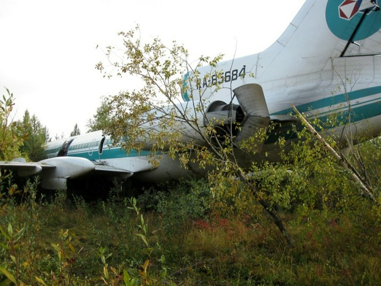 Image: A Russian passenger Tupolev (TU-154) stands in a forest near a neglected airport outside the village of Izhma