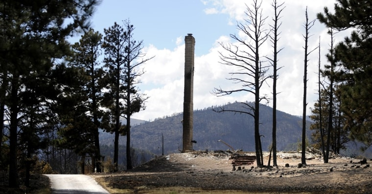 Image: A chimney of a home destroyed by the Fourmile Canyon fire remains standing near Sunshine Canyon in Boulder, Colorado
