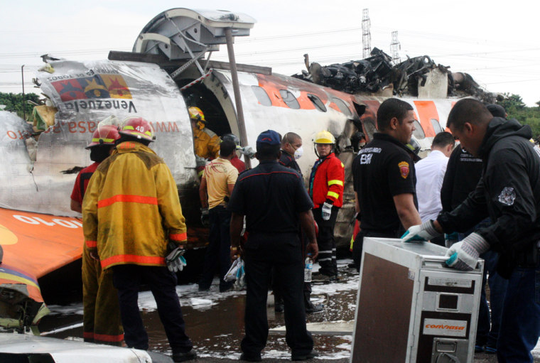 Image: Rescue workers search for victims at the place where a ATR-42 plane crashed in Puerto Ordaz