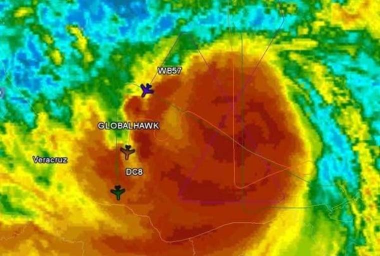 Image: Planes trek through Hurricane Karl