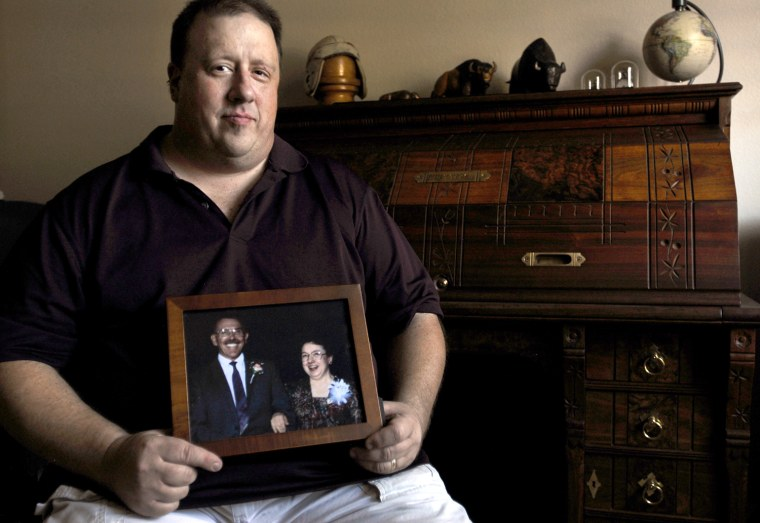 Craig Kurtz holds a framed photo of his father and mother, who were killed in a plane crash six years ago near Raleigh, N.C. The small aircraft Jerome and Carolyn Kurtz were trying to landcontained no black box recorder and investigators were unable to determine the cause of the crash. Most small planesare not required to have any kind of data recorders, even though they account for most airplane accidents.