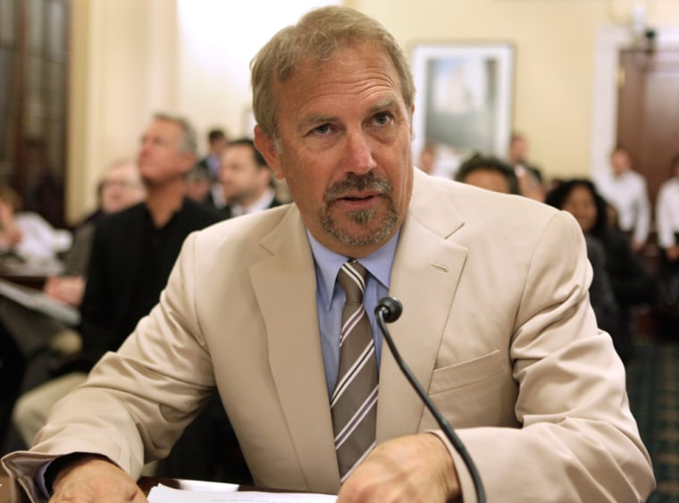 Image: Actor Kevin Costner prepares to testify before the House Homeland Security hearing on Capitol Hill in Washington