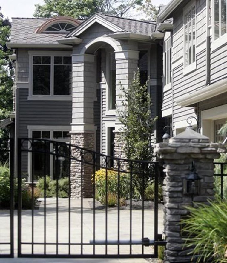 This foreclosed mansion in Kirkland, Wash. is one of three being targeted by the same squatters who tried to take over one in June 2010.