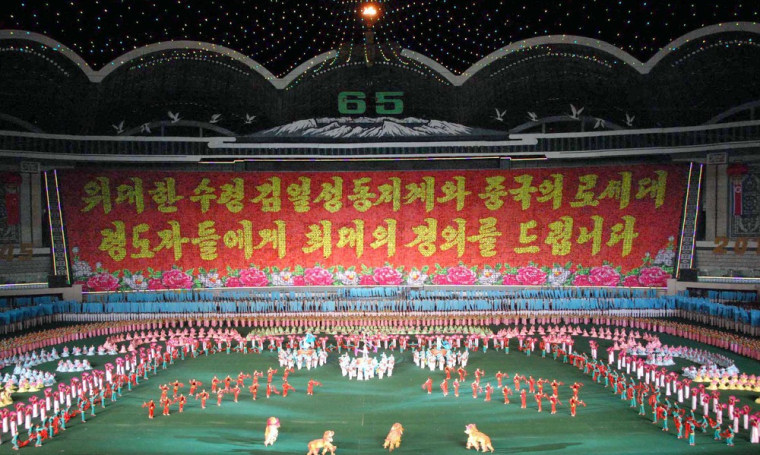 """Image: North Koreans perform Arirang Mass Games' chapter 5, named """"Goodwill Arirang"""" in Pyongyang in this photo released by North Korea"""