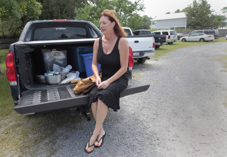 Image: Margaret Carruth sits on the tailgate of her pickup truck