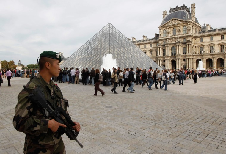 Image: French soldiers patrol around the Louvre museum in Paris