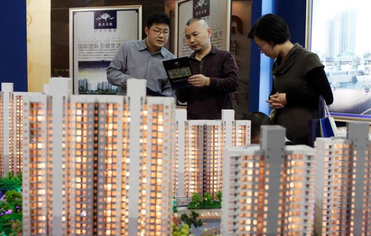 Image: Visitors at a housing fair in Shanghai
