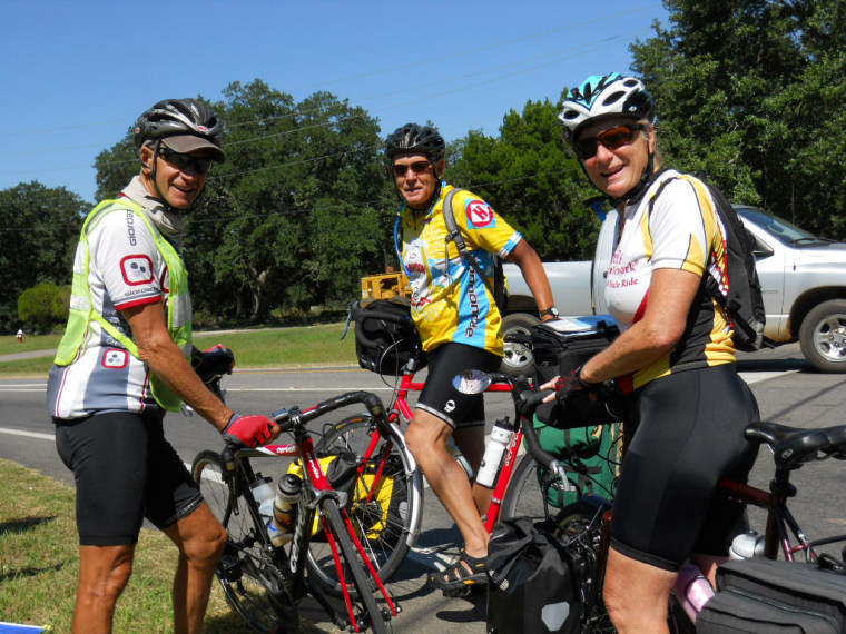 "Roger Grooters, left, with cyclists Norb and Ann Bagley on Oct. 3. Regarding the day's ride, Roger said, ""We left Ocean Springs, MS at 8:45 AM on another beautiful day. Last night I was not feeling good and was not sure how far I could bike today, but after a slow begining I started feeling strong again, ending the day with 104.8 miles for a total of 2078.7 miles."""