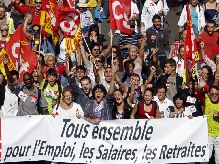 Image: Private and public sector workers demonstrate over pension reforms in Marseille