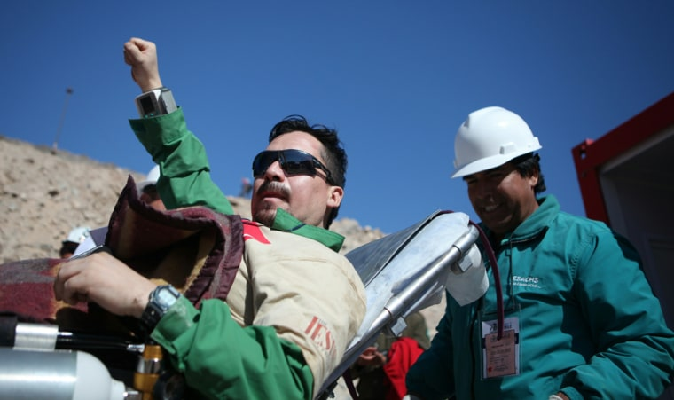 Image: Chilean miner Edison Pena is taken on a
