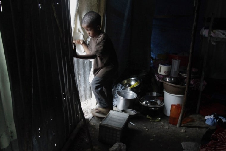 Image: Stuard Lucner Tombeau, 4, exits his temporary home in a refugee camp