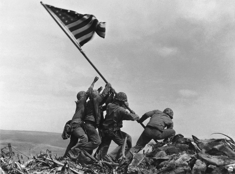 Image: U.S. Marines of the 28th Regiment of the Fifth Division raise the American flag atop Mt. Suribachi, Iwo Jima